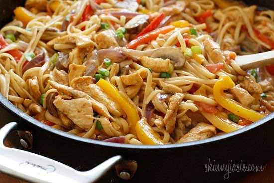 Cajun Chicken Pasta is lightened up, made with chicken strips, bell peppers, red onion, mushrooms and scallions in a creamy light Cajun sauce.