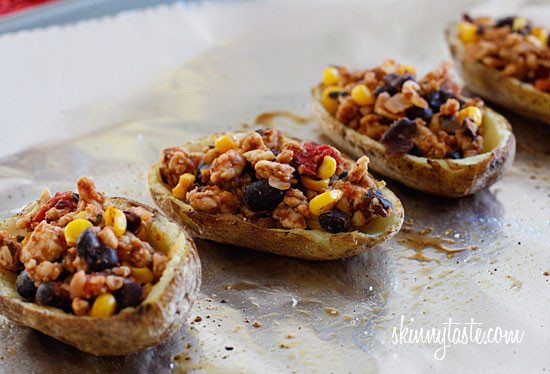 Skinny potato skins loaded Santa Fe style with mildly spiced turkey, black beans, corn and tomatoes topped with cheese - you won't be able to stop at just one!