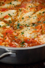 Cajun spices, tomatoes, onions and peppers give any white fish extra pizazz and a little kick. Super easy and quick!