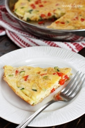 Caramelized onions, sauteed red bell peppers and zucchini combined create a winning egg frittata breakfast dish.