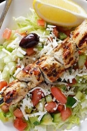 Marinated chunks of grilled chicken breast served over a bed of lettuce with feta, fresh diced tomatoes, cucumbers, green peppers, black olives, red onions, parsley and dill tossed in olive oil and fresh lemon juice.