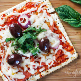 A matzo cracker makes a great base for a pizza that kids and adults will love! Top it with your favorite vegetables and cheese and you have yourself a quick meal.