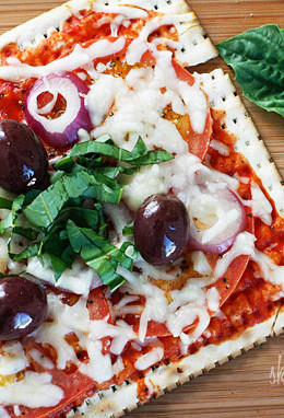 A matzo cracker makes a great base for a pizza that kids and adults will love for Passover! Top it with your favorite vegetables and cheese and you have yourself a quick meal.