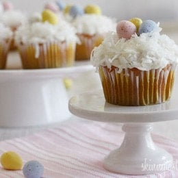 A quick and easy coconut cupcake made with a box white cake mix as a base. No butter or oil was used in this recipe, I simply swapped out the oil for light coconut milk and apple sauce. Sweetened coconut flakes are combined with a light cream cheese frosting for a divine finish!