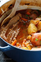 Lean beef brisket slowly braised in the oven with potatoes, carrots and onions. Perfect for Passover or Easter dinner. Slicing the brisket half-way through cooking assures that the meat is tender and flavorful.