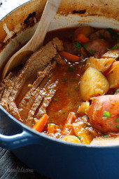Lean beef brisket slowly braised in the oven with potatoes, carrots and onions. Slicing the brisket half-way through cooking assures that the meat is tender and flavorful. Perfect for Passover or Easter dinner.