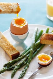 "Strips of whole wheat toast ""soldiers"" and crisp tender asparagus dipped into a soft boiled egg, if that's not the perfect Spring breakfast, I don't know what is!"