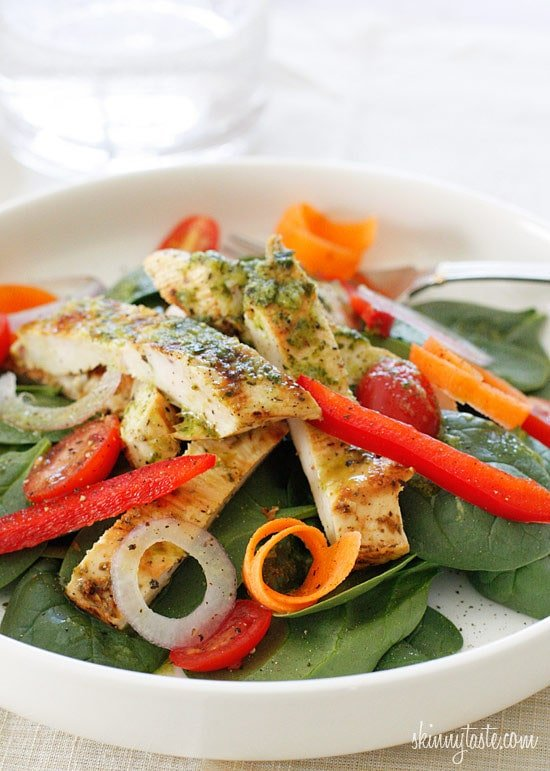 Chicken marinaded with lemon, garlic and oregano, then grilled to perfection and served over a colorful spinach salad. Topped with a white balsamic vinaigrette, does it get better than that?