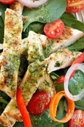 Chicken marinaded with lemon, garlic and oregano, then grilled to perfection and served over a colorful spinach salad with a white balsamic vinaigrette, does it get better than that?