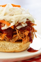 Pulled pork is one of those dishes you can serve all year round. It's perfect for pot lucks or large gatherings because you can feed a crowd without slaving in the kitchen. I came up with this leaner version using boneless pork loin roast and homemade BBQ sauce which gave me complete control of what was added.