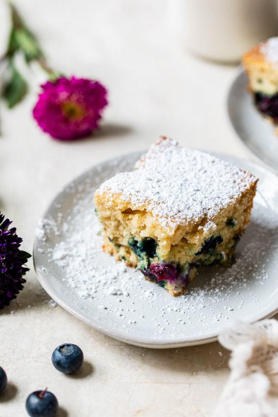 A slice of Blueberry Buttermilk Cake on a plate.