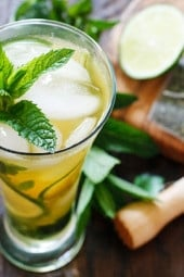 The perfect summer cocktail, a cross between a tall glass of fresh brewed iced green tea and a mojito! I think this is going to be my signature drink all summer, it's icy cool, and has the added bonus of antioxidant rich green tea.