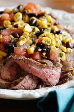 This steak dish has a fiesta of flavors, the flank steak is seasoned with cumin and garlic and grilled to perfection, then topped with a fresh black bean, corn and tomato salad for a quick and tasty family friendly weeknight meal.