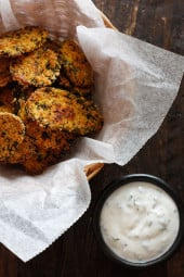 Cornmeal panko herb crusted dill pickles baked in the oven until golden and crisp with a light buttermilk ranch dip. Have you ever had fried pickles?