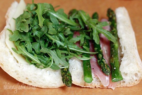 Melted Swiss cheese, asparagus, prosciutto, arugula and garlic mayonnaise pressed in a ciabatta panini. Did that just make your stomach growl?