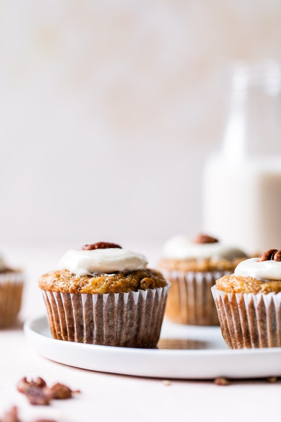 These super moist hummingbird cupcakes are light, full of pineapple, chopped bananas, pecans, cinnamon and spices topped off with a sweet cream cheese frosting.