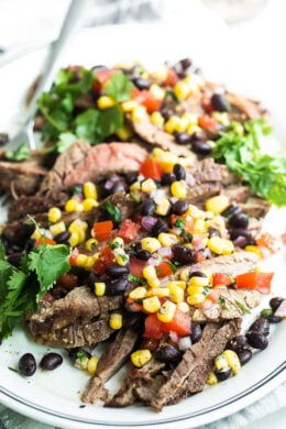 steak with tomatoes, corn and black beans