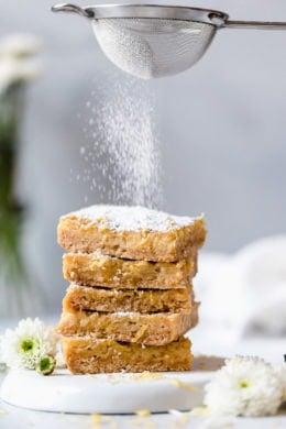 Pucker Up! These sweet and tangy Honey Lemon Bars made with fresh lemon, lemon zest and honey and a whole wheat shortbread crust are a little lighter than traditional lemon bars, but are so tasty and hard to resist.