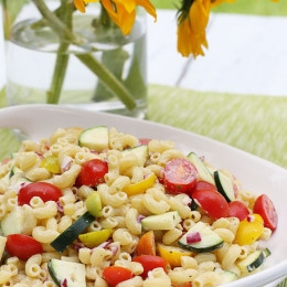 This is the perfect summer pasta salad loaded with fresh summer tomatoes and zucchini tossed in a light creamy dressing. I even snuck in some Greek yogurt for added creaminess but with all the other flavors you won't know it's there.