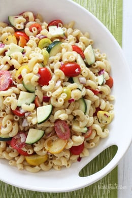 Macaroni Salad with Tomatoes and Zucchini is the perfect summer pasta salad loaded with fresh summer vegetables tossed in a light creamy dressing.