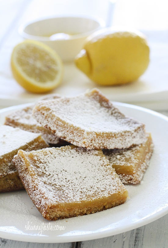 Pucker Up! These sweet honey and tangy lemon bars are lighter than traditional lemon squares, but are not lacking in flavor! The sweet and tart topping is made from fresh lemon juice, lemon zest and sweetened with honey atop a shortbread crust. Perfect for potlucks, back yard parties and picnics.