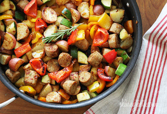 Lean Italian chicken sausage with summer bell peppers and zucchini sauteed with baby red potatoes and fresh herbs for a quick one pot meal.
