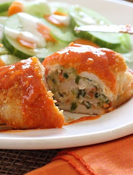 Buffalo Chicken breast stuffed with cheese, shredded carrots and minced celery, then rolled, breaded, baked and drizzled with hot sauce. Sound enticing? It should be, this is good stuff!