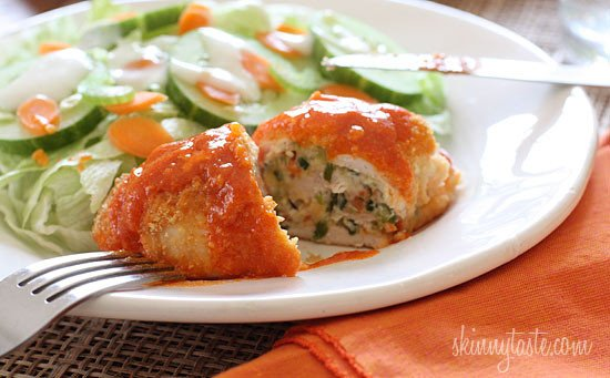 Buffalo chicken breast stuffed with cheese, shredded carrots and chopped celery, then rolled, breaded, baked and drizzled with hot sauce. Sound alluring? It should be, these are good things!