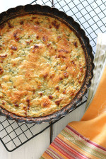 Crust-less Summer Zucchini Pie – a simple savory pie made with zucchini, shallots, mozzarella and parmesan cheese. If you're looking for a tasty way to use up your summer zucchini, this is it! This makes a wonderful side dish to any meal or serve it at a potluck or brunch.