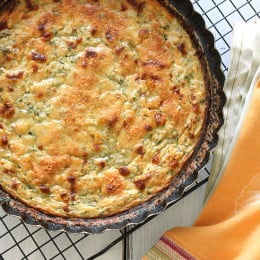 A simple savory pie made with summer zucchini, shallots, mozzarella and parmesan cheese. If you're looking for a tasty way to use up your summer zucchini, this is it!