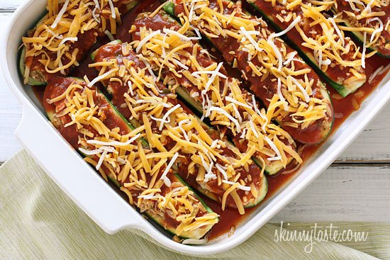 A fun twist on a Mexican favorite! Summer zucchini hollowed out and stuffed with shredded chicken, enchilada sauce, cheese and scallions. Serve this with cilantro lime rice and you'll have yourself a fiesta!