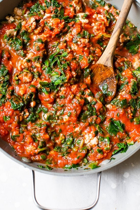 sauce with sausage and spinach