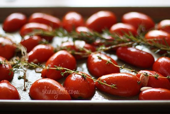 Summer plum tomatoes roasted in the oven with garlic and herbs make an easy, delicious homemade tomato sauce that will fill the room with an intoxicating aroma.