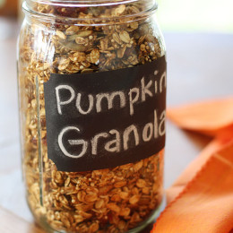 Homemade pumpkin granola made with oats, quinoa, maple, pumpkin spice, cinnamon, pecans, pepitas and dried cranberries.