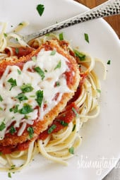 Baked Chicken Parmesan is a lightened up version of an Italian classic! Baking the cutlets instead of frying lightens this dish up while remaining moist and full of flavor, plus it's so much cleaner and easier. Serve this over pasta or with a large salad to keep it on the lighter side.