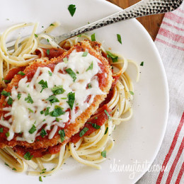 The Best Chicken Parmesan recipe, made a bit healthier! Breaded chicken cutlets are baked, not fried yet the chicken is so moist and full of flavor.