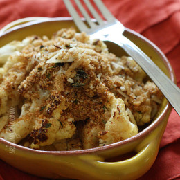 Cauliflower, tossed with a little olive oil, garlic, salt and pepper then roasted in the oven transforms this powerful cruciferous vegetable into a nutty, delicious side dish, especially when topped with toasted bread crumbs.