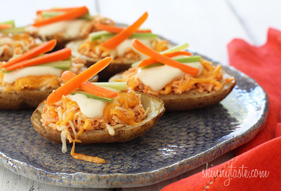 These potato skins are stuffed with shredded buffalo chicken breast made in the crock pot, topped with melted cheese, blue cheese dressing, carrots and celery – they are seriously delicious! What's football without the appetizers.