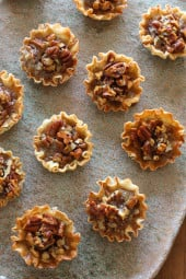 These bite sized pecan tarts are the perfect lighter alternative for pecan pie this holiday season! They are so easy to make, just 7 ingredients for a delicious treat.