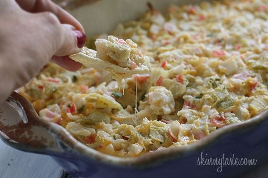 Hot and cheesy imitation crab and artichoke dip is to die for! Serve this glorious dip with baked chips and you will have the perfect appetizer for any party.