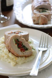 Pork tenderloin stuffed with prosciutto, mozzarella, baby spinach and sun dried tomatoes; a wonderful dish for the Holidays. Serve this with potato parsnip mash, skinny garlic mashed potatoes, or creamy cauliflower puree and some roasted vegetables on the side.