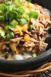 Slow cooked shredded chicken with corn, tomatoes and black beans. Prep this the night before and turn your crock pot on in the morning for an easy weeknight meal.
