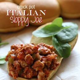 Turkey sausage, peppers and onions slow cooked in the crock pot with crushed tomatoes and spices for an easy weeknight meal. Serve this on a roll with baby spinach and melted cheese if desired for a sloppy yet delicious sandwich.
