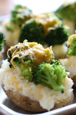 These twice baked potatoes are so cheesy, stuffed with broccoli and cauliflower, and so guilt-free that you'll never have to think twice about making them!