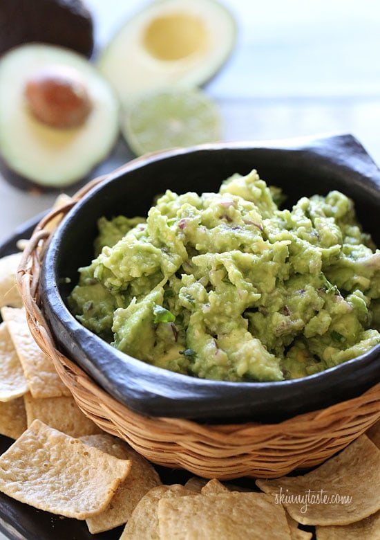 This is the Best Guacamole Recipe and it's super easy and simple to make with only 5 ingredients. Guacamole is a staple at every gathering and also a must when we have taco nights. Tommy is always in charge of making the guac, and he has converted many non-avocado lovers with this recipe.