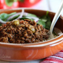 Picadillo, a flavorful Cuban dish made with ground beef and a sauce made from simmering tomatoes, green olives, bell peppers, cumin, and spices is one of my family's favorite weeknight meals.