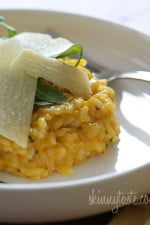 A rich and creamy Italian rice risotto dish made with butternut squash puree, white wine, Parmigiano-Reggiano and topped with a little fresh arugula.