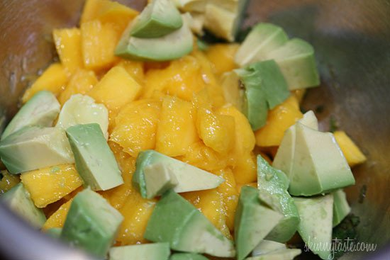 Pork roast, marinated overnight with fresh citrus juice, garlic, and jerk seasoning slow cooked all day, topped with a bright Caribbean salsa of fresh mangos, avocado and cilantro.