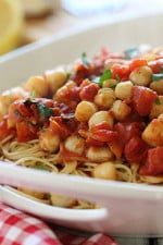 Sauteed bay scallops with tomatoes and a touch of white wine and lemon juice served over angel hair pasta.
