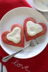 Lightened-up red velvet pancakes made with a blend of white whole wheat flour and all purpose, then topped with a light cream cheese topping. I adore red velvet, so I can't think of a more fitting time to make red velvet pancakes, then for Valentine's Day!